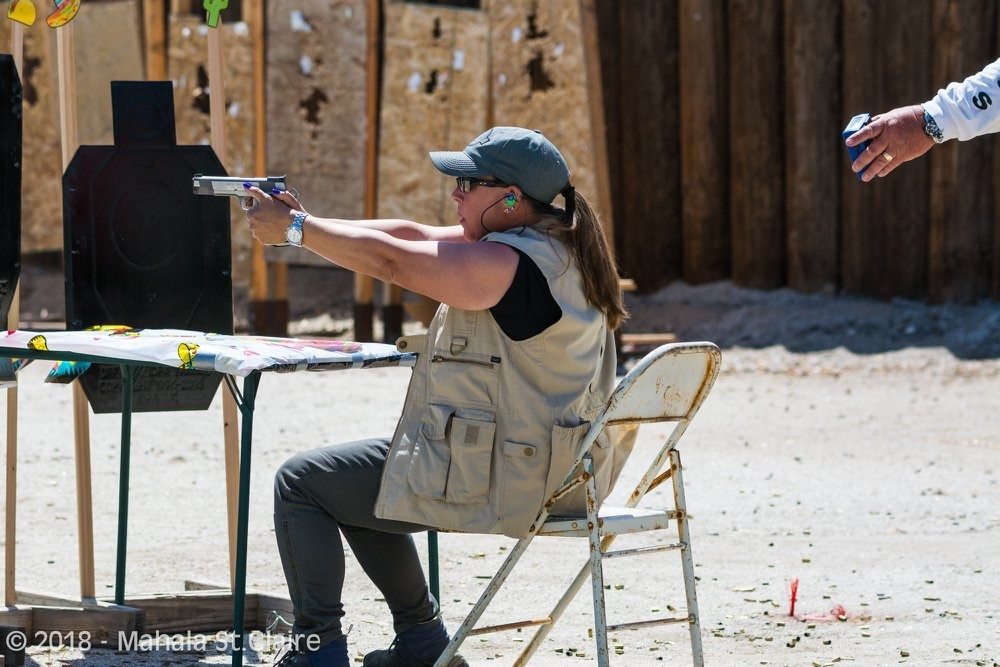 Naomi Moss shooting while seated